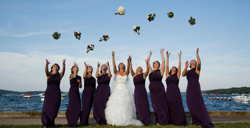 bridal party throwing bouquet