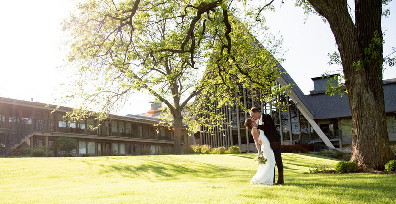 wedding couple in front of abbey a-frame in the spring