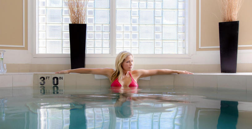 woman relaxing in avani spa whirlpool