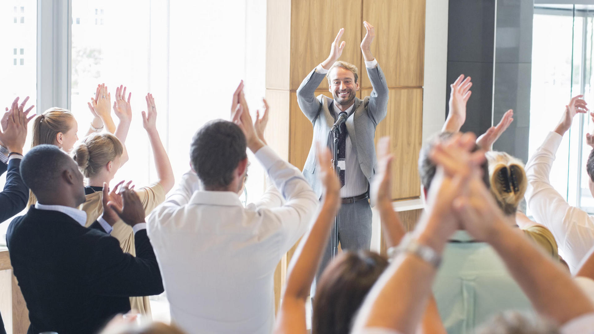 people applauding in a meeting