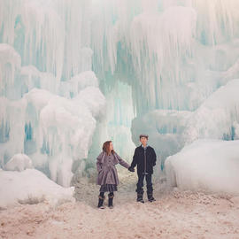 siblings holding hands in ice castle