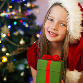 girl in front of christmas tree