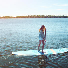 woman on stand up paddleboards
