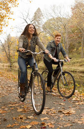 couple biking in fall