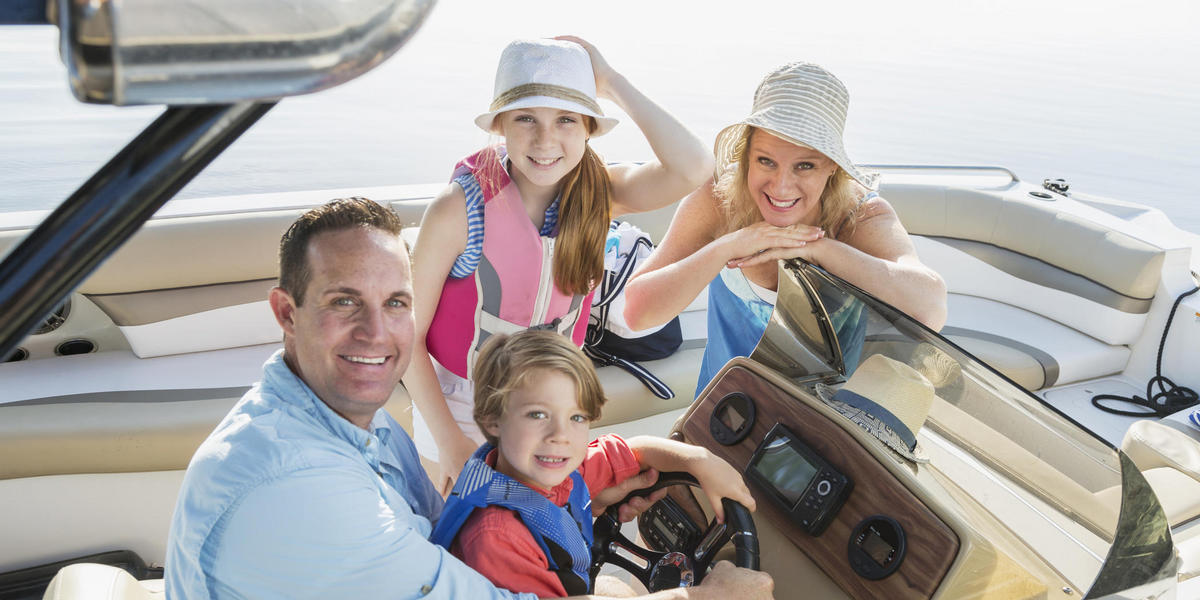 photo of a family on a boat