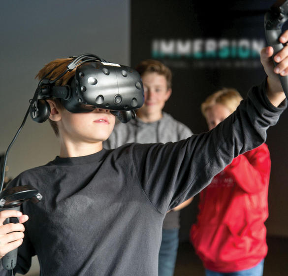 boys playing virtual reality games in immersion